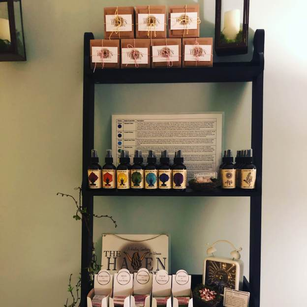 shelf filled with aromatherapy products at the haven shoppe