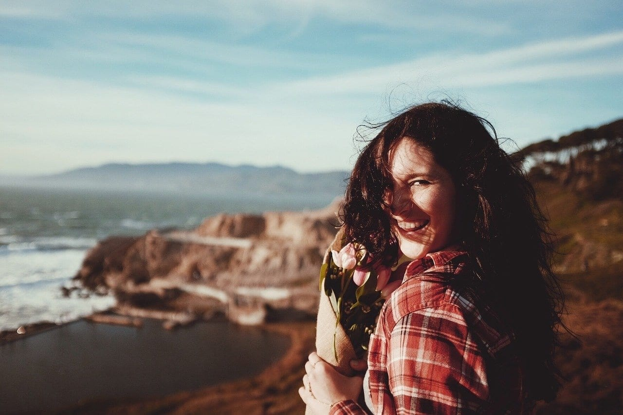 smiling woman outdoors