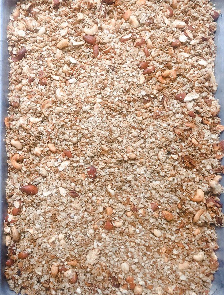 Baked granola on a raised baking sheet