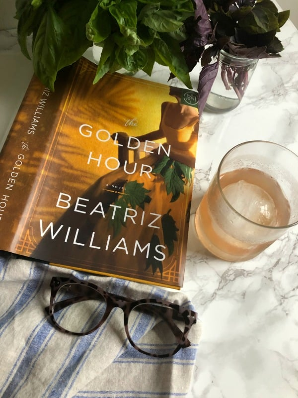 The Golden Hour by Beatriz Williams with glasses and a cocktail.