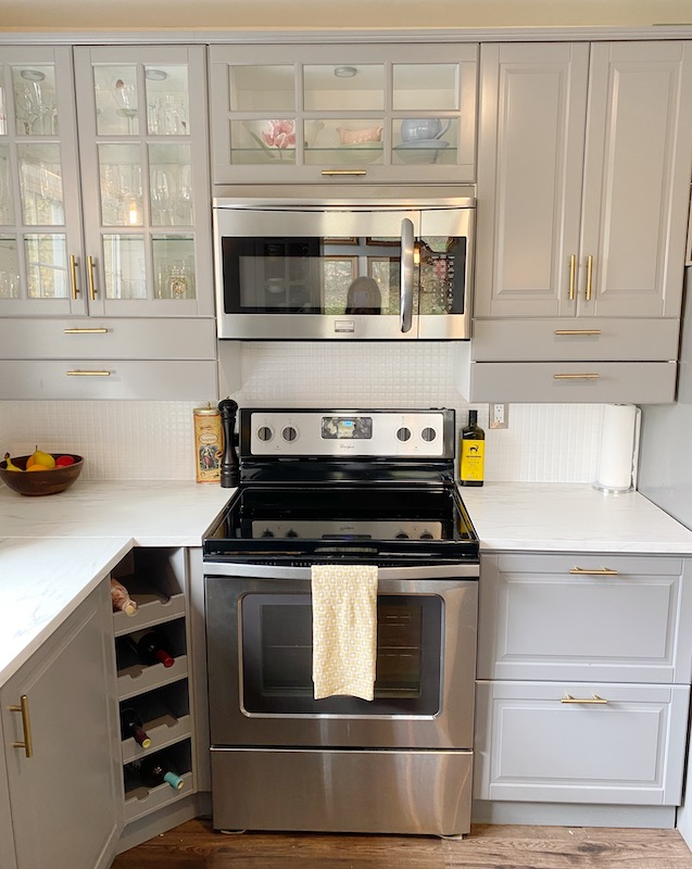 My complete kitchen makeover on a budget of less than $300. How I painted glass tile white and added brass hardware.