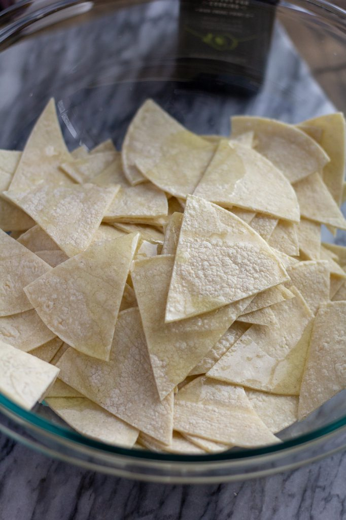 Bowl of tortilla wedges drizzled with avocado oil