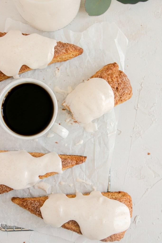 half eaten scone with a cup of espresso