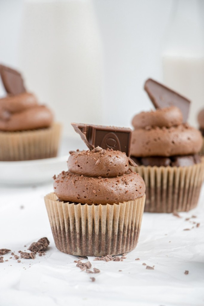 triple chocolate cupcake with a chunk of chocolate