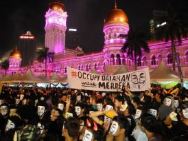 http://commons.wikimedia.org/wiki/File:V_for_Merdeka_flash_mob_protest_on_New_Year%27s_Eve.jpg