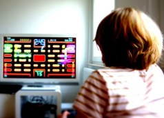 http://commons.wikimedia.org/wiki/File:Girl_plays_Pac_Man.JPG