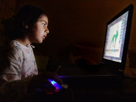 http://commons.wikimedia.org/wiki/File:Child_and_Computer_08473.jpg
