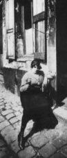 https://commons.wikimedia.org/wiki/File:Atget_prostitute_taking_her_shift.jpg