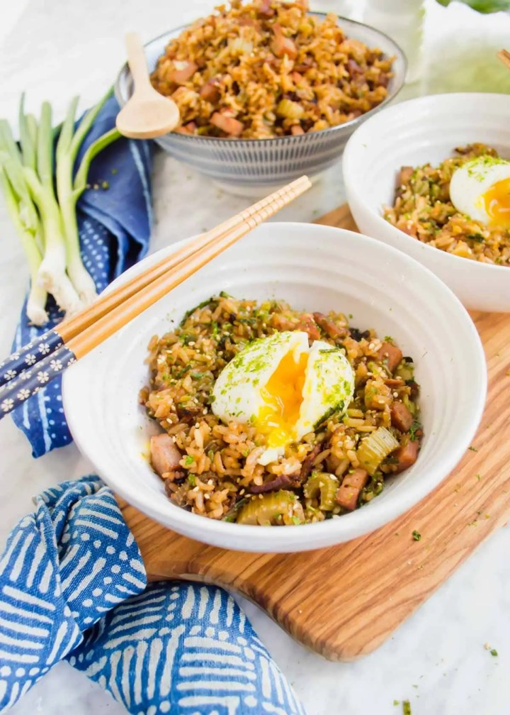 Shoyu Breakfast Fried Rice in bowls with soft boiled egg.
