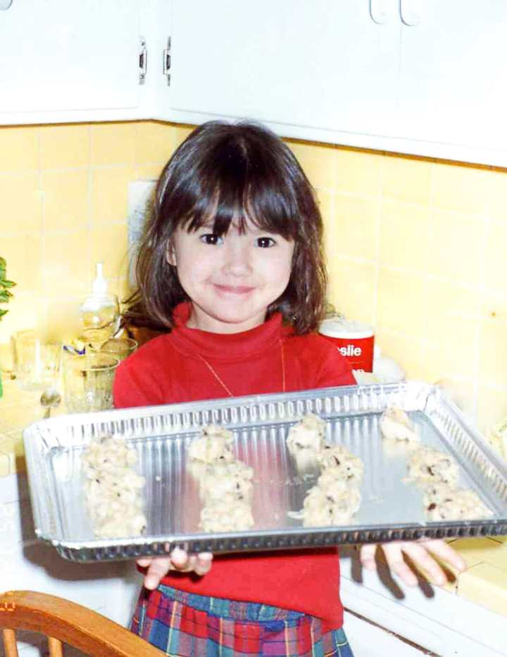 The Heirloom Pantry - Young Kat holding cookie tray
