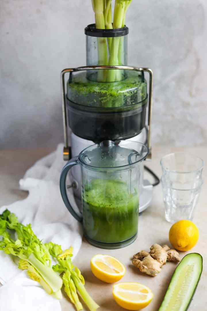 Glowing Skin Green Juice in Breville Juicer, lemon, kale, celery, ginger - The Heirloom Pantry