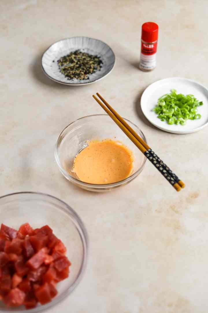 Spicy Kewpie Mayo Sauce in a glass bowl. Kewpie Mayo, togarashi, Sriracha, sesame oil, mirin