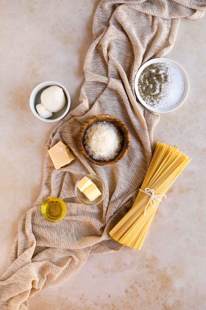 Cacio e pepe ingredients flatlay.