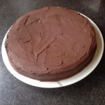 Gluten-free cake made with King Arthur's gluten-free cake mix and Simple Mills organic chocolate frosting