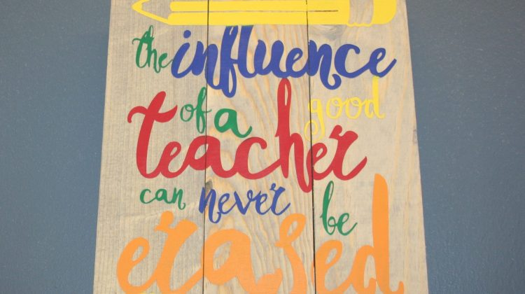"Sign that says ""The influence of a good teacher can never be erased"""