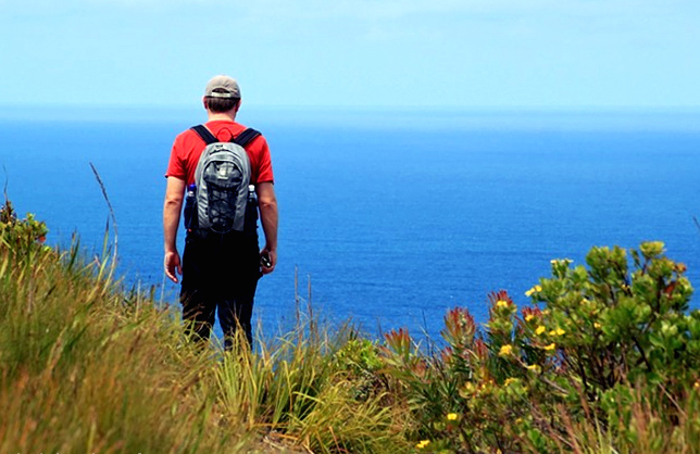 Man-hiking-by-ocean
