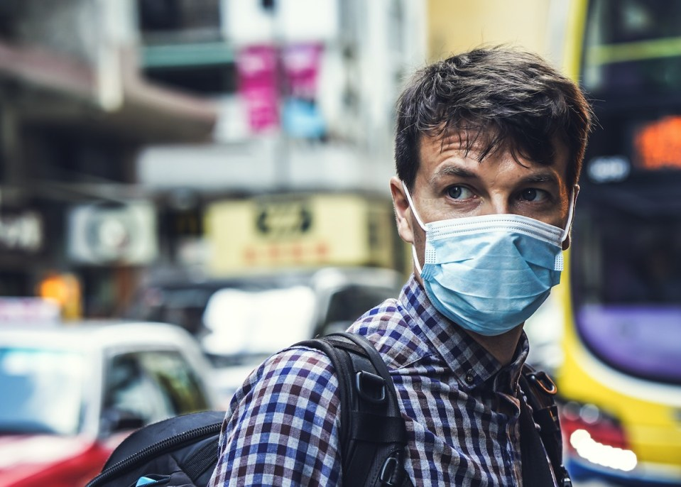 man with respiratory mask in city