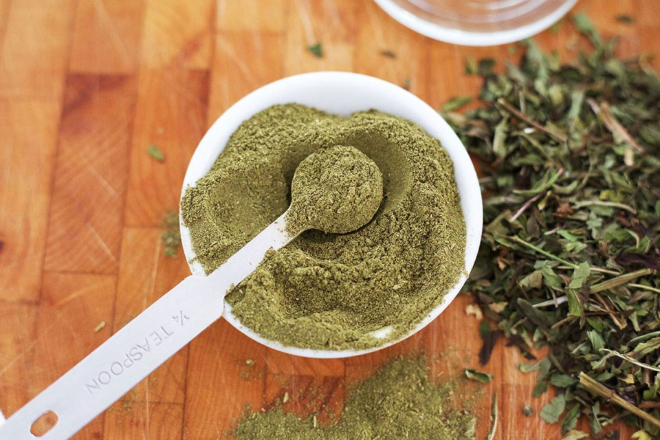 Powdered holy basil in bowl on table