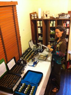 Maria is the newest member of our clinic crew. She is standing at the apothecary making notes on a case. We have quite a wonderful array of remedies to work with, thanks to the donations of many, including Red Moon Herbs and Traditional Medicinals.