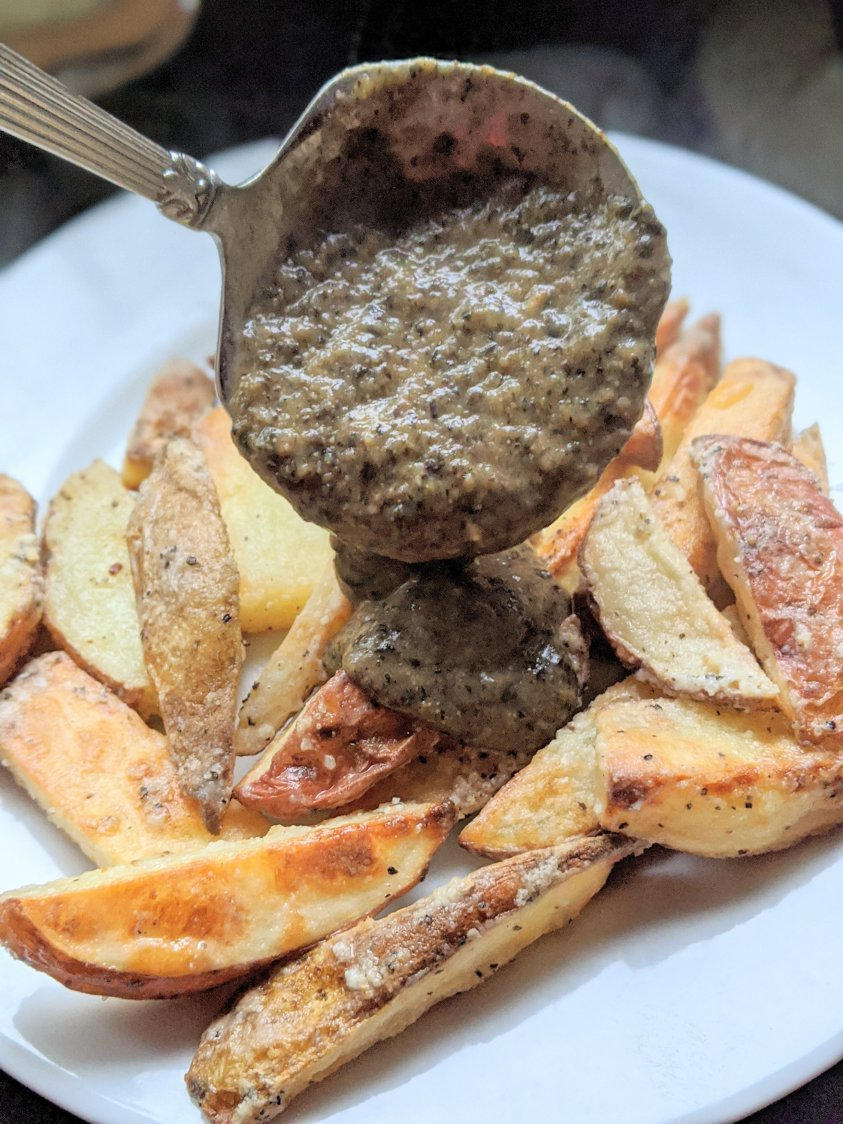 Chunky mushroom gravy with spices herbs de provence nutritional yeast fries potatoes cheese curds poutine vegan vegetarian meatless recipes recipe