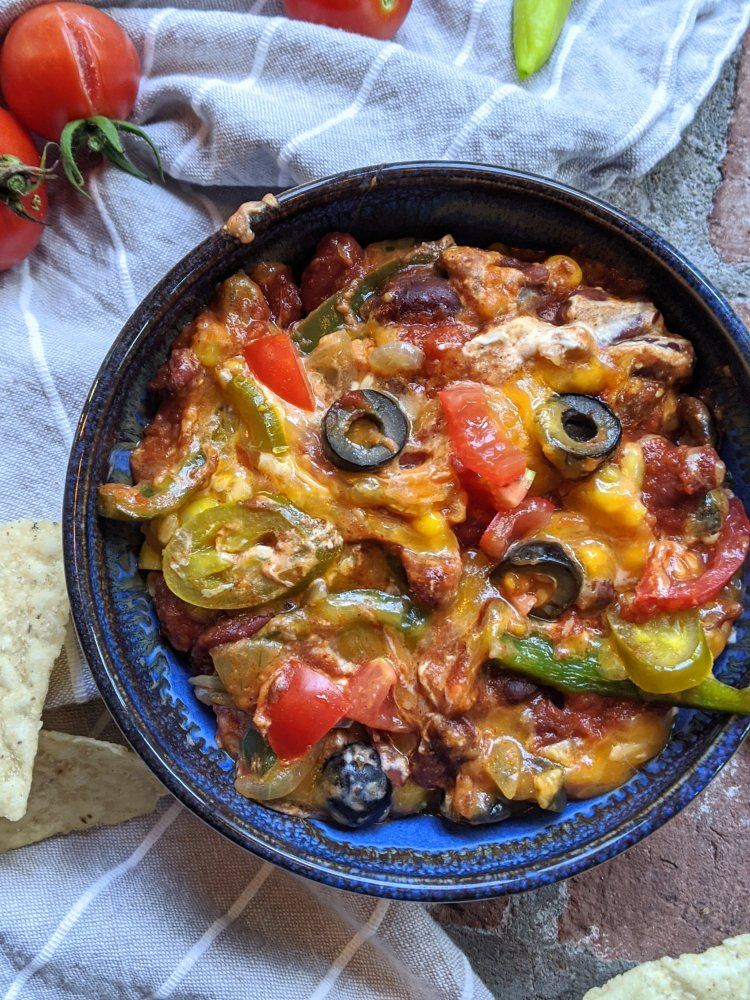 vegan 7 layer dip healthy high protein dairy free vegetarian gluten free dairy free loaded with vegetables olives jalapenos chili cream cheese salsa beans