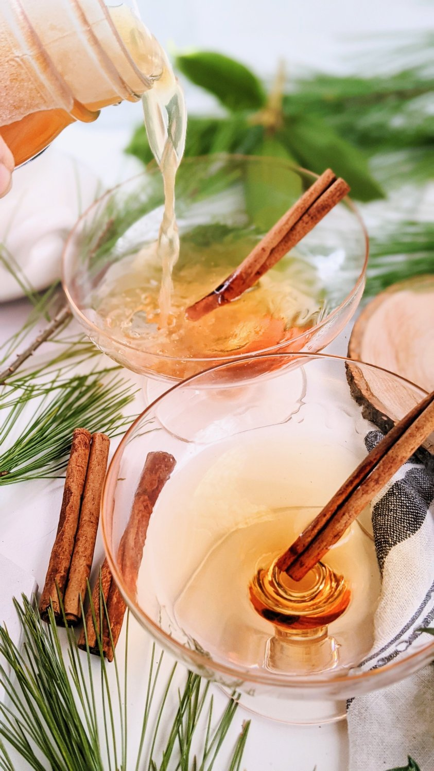 apple cinnamon drinks warm holiday festive drinks for winter fall autumn hot mulled cider recipe with moonshine apple cider juice and cinnamon