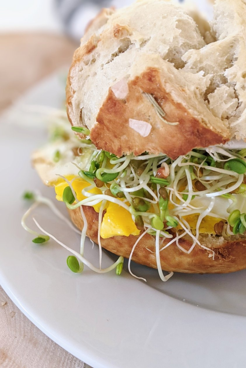 pretzel breakfast sandwich recipe with pretzel bread eggs sprouts and toppings for a breakfast bar ideas for weddings rehearsal dinners mother's day brunch ideas