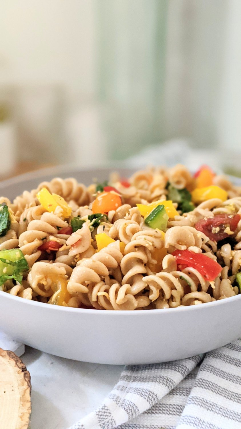 no meat pasta salad for summer vegetarian sides for bbq pasta side dishes for entertaining healthy gluten free vegetarian pasta salad with tomatoes cucumbers peppers and homemade pasta salad dressing