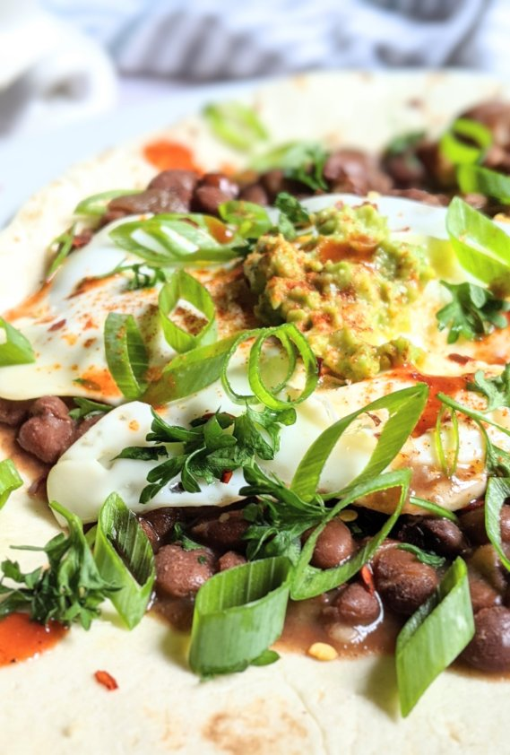 pinto beans huevos rancheros gluten free recipe poached eggs corn tortilla huevos rancheros with spicy pinto beans and tapatio hot sauce for breakfast beans recipes or brunch eat beans for breakfast