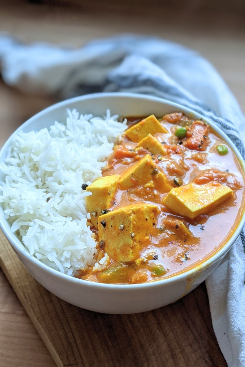 vegan indian tofu recipes todu du pyaza recipe in a bowl with basmati rice a creamy tofu curry with indian spices turmeric coriander seeds and peas