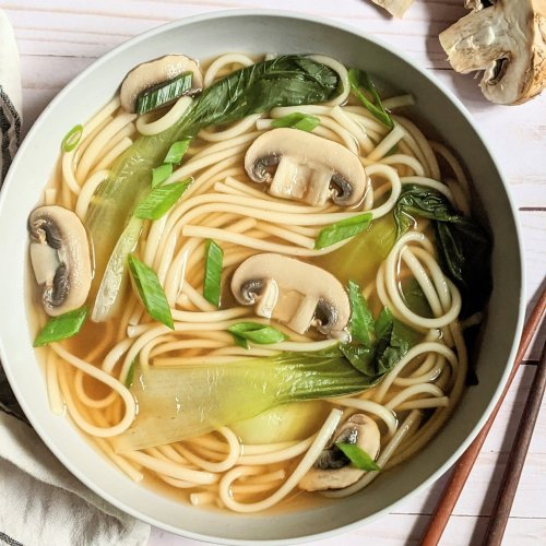 vegetarian udon noodle soup recipe with mushrooms kale boy choy and green onions delicious and creamy udon noodle soup asian inspired by japanese cuisine