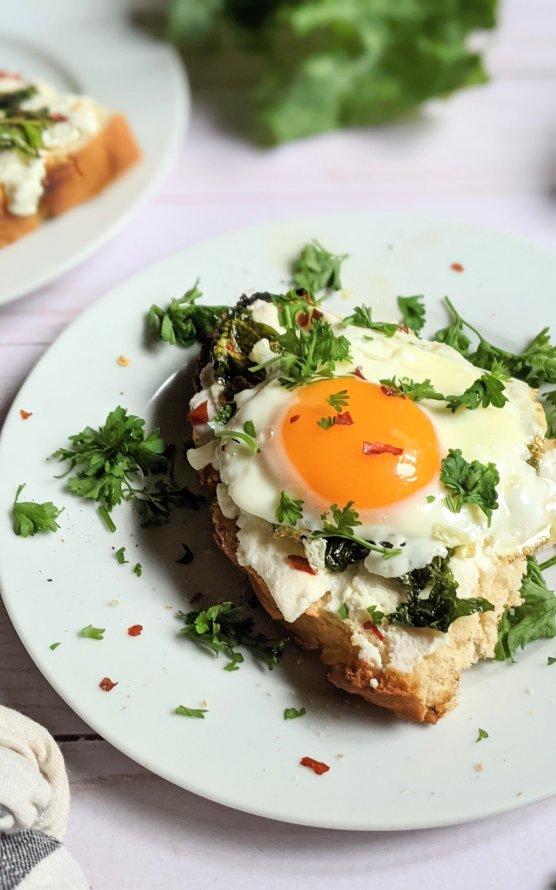 ricotta and egg toast with creamy cheese recipe gluten free bread with ricotta cheese sauteed garlic and kale a fried egg and parsley healthy breakfast high protein