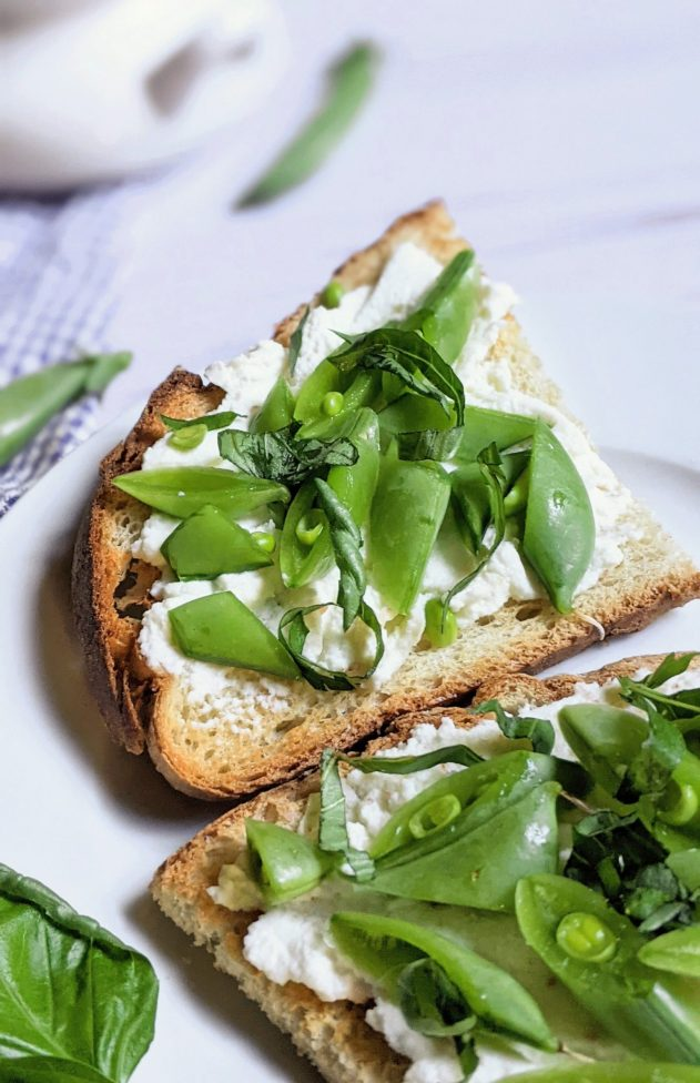 close up of ricotta toast with snap peas and basil breakfast toast with fresh peas