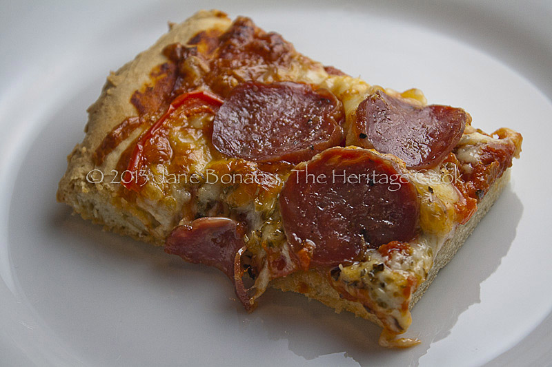 Slice of gluten-free pizza on white plate