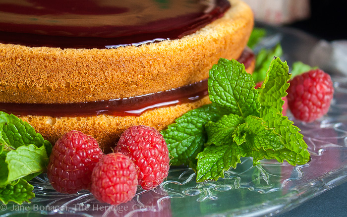Almond-Raspberry Cake with Chocolate-Cassis Glaze; The Heritage Cook 2013.