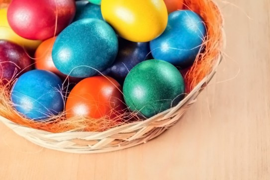 Basket of beautiful, vibrantly colored Easter Eggs