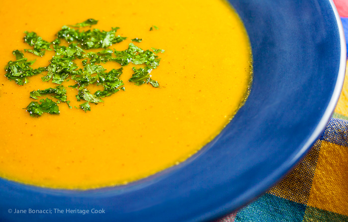 A big healthy bowl of roasted carrot and sweet potato soup, filling and delicious on crisp autumn days and all winter long