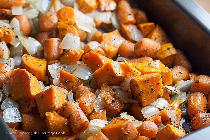 Hot from the oven, roasted carrots, sweet potatoes, and onions, ready to turn into soup