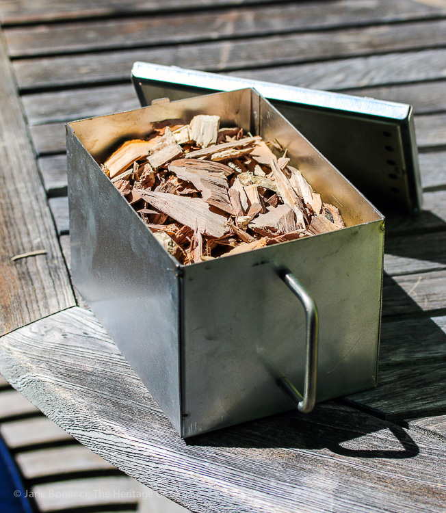 Smoker box filled with wood chips