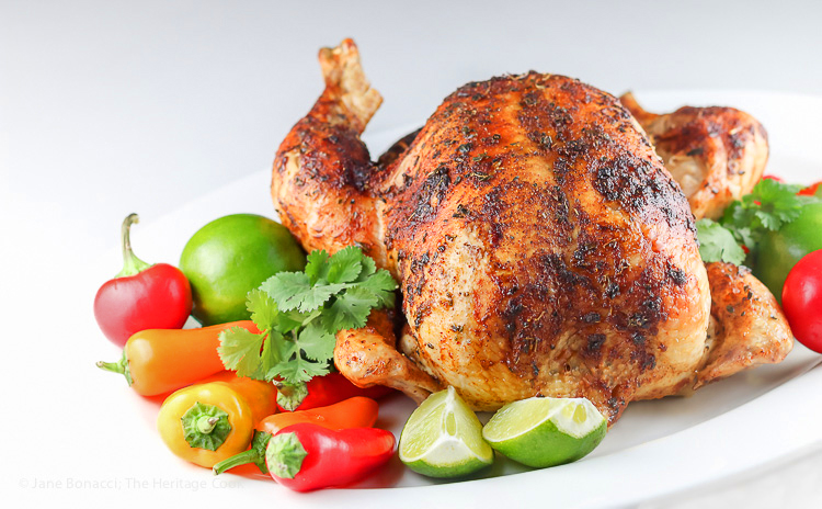 Gorgeous roasted Peruvian chicken, ready to serve; Pisco Brandy Roasted Peruvian Chicken, Gluten-Free © 2016 Jane Bonacci, The Heritage Cook