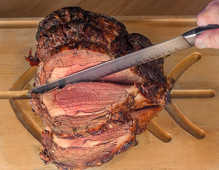 Carving the grilled prime rib roast; Succulent Grilled Prime Rib (Gluten-Free); © 2016 Jane Bonacci, The Heritage Cook