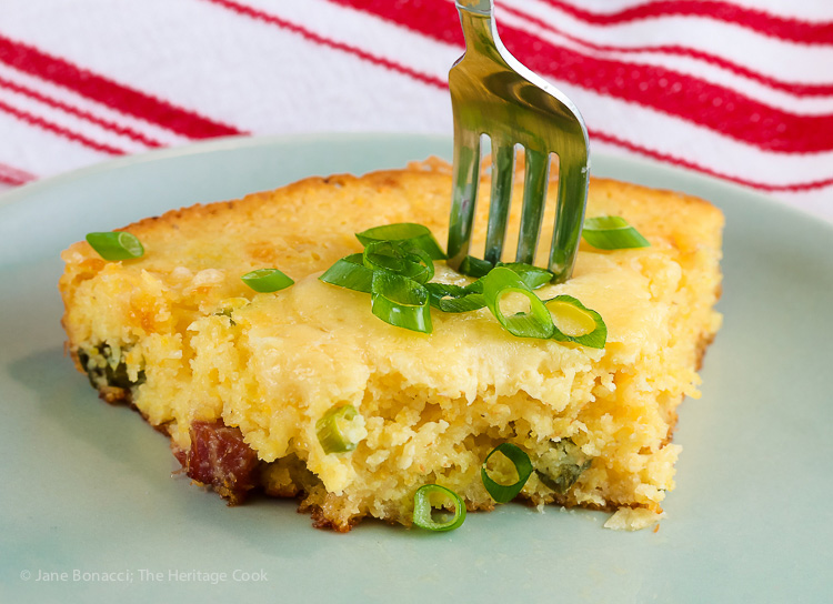 Fork stuck in slice of Cheesy Skillet Cornbread with Cheddar and Tasso Ham © 2017 Jane Bonacci, The Heritage Cook