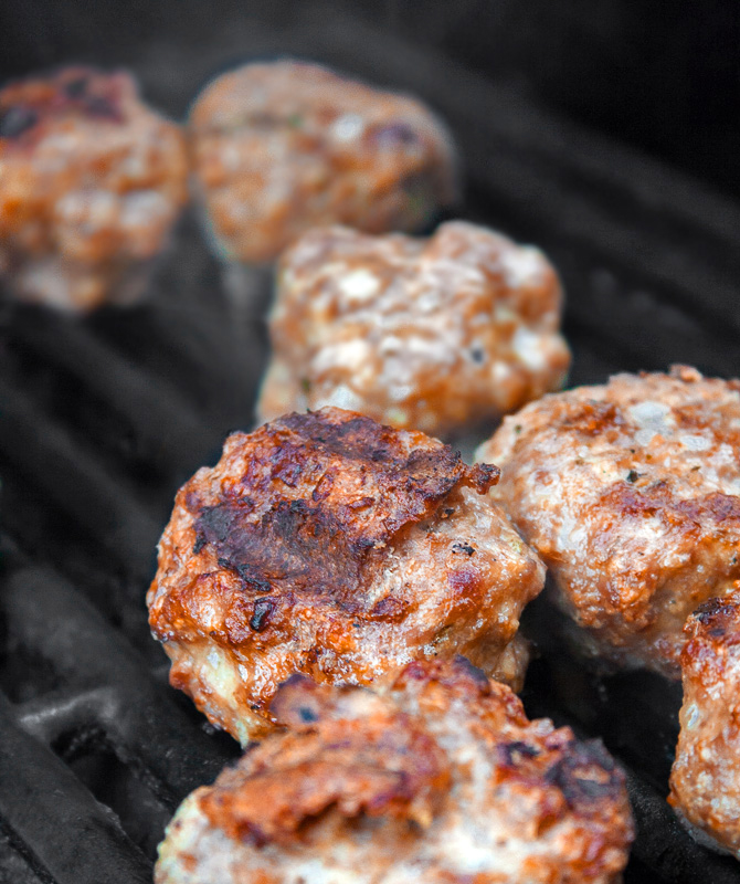 Meatballs cooking on the BBQ; Grilled Meatball Hoagie Sandwiches with Spicy Tomato Sauce and Melted Cheese © 2018 Jane Bonacci, The Heritage Cook
