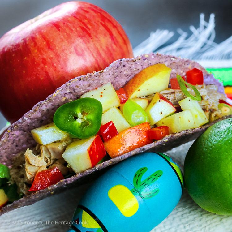 top down image of pork tacos with apple salsa, lime, apple; Stemilt Piñata Apple Salsa with Pork Tacos © 2018 Jane Bonacci, The Heritage Cook