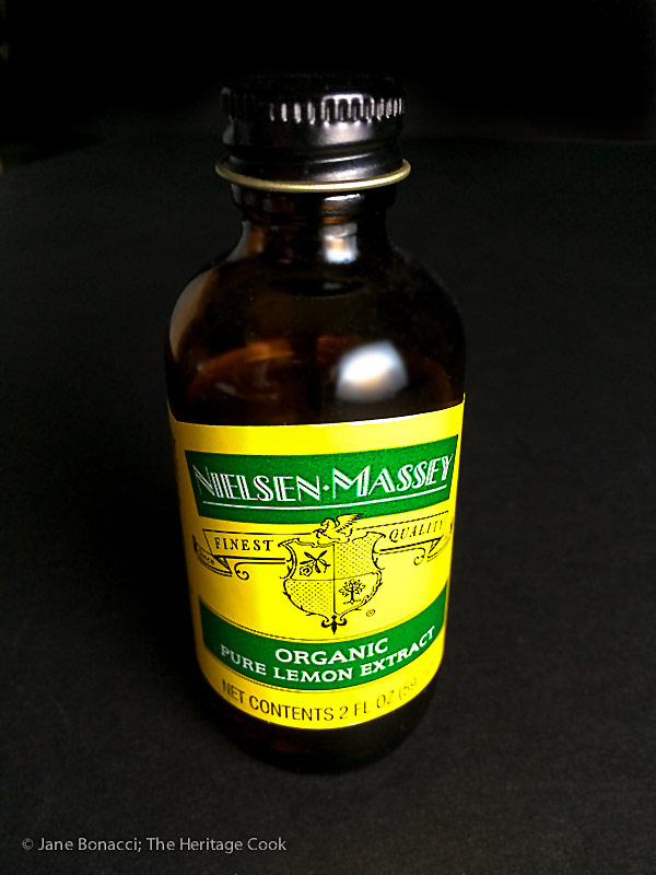 Nielsen Massey's Lemon Extract bottle; Sculptured Lemon Buttermilk Pound Cake © 2018 Jane Bonacci, The Heritage Cook