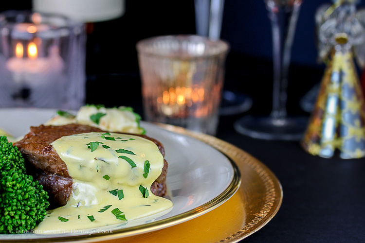 Steak and sauce in front of holiday candles; Holiday Foolproof Béarnaise Sauce (Gluten Free) © 2018 Jane Bonacci, The Heritage Cook