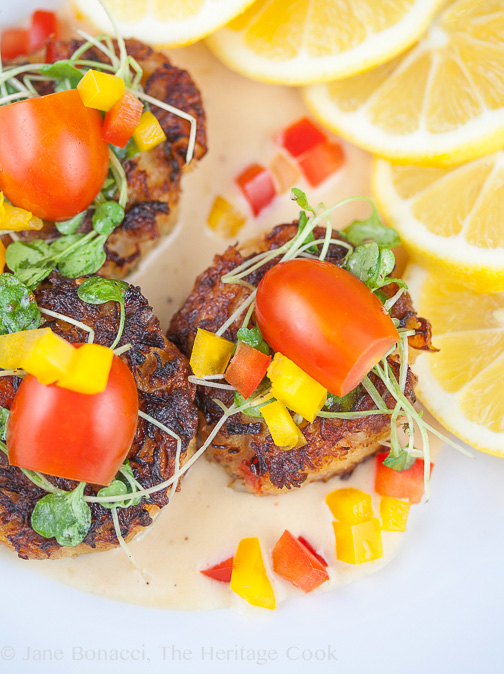 plate of crab cakes with slices of fresh lemon; Crab Cakes with Thai Lemongrass Sauce © 2018 Jane Bonacci, The Heritage Cook