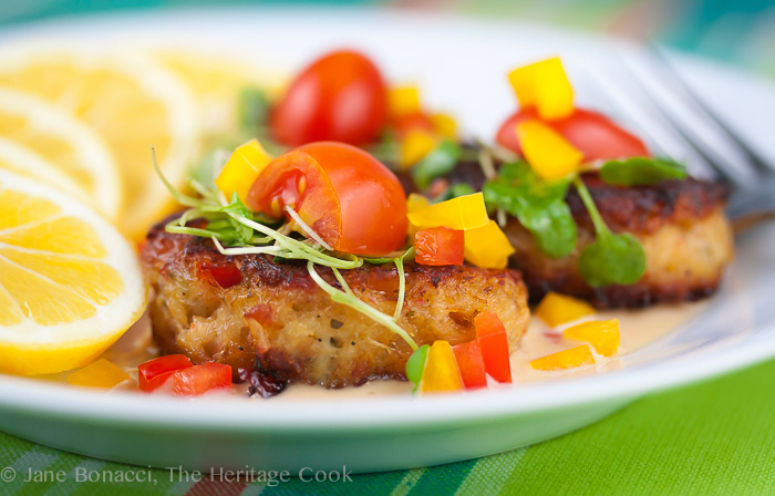 side on view of crab cake with toppings; Crab Cakes with Thai Lemongrass Sauce © 2018 Jane Bonacci, The Heritage Cook
