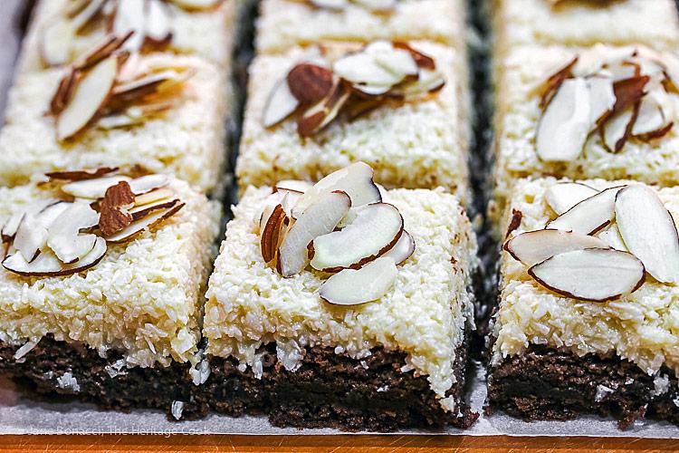 almonds on top of brownies; Rich Coconut Almond Brownies © 2019 Jane Bonacci, The Heritage Cook