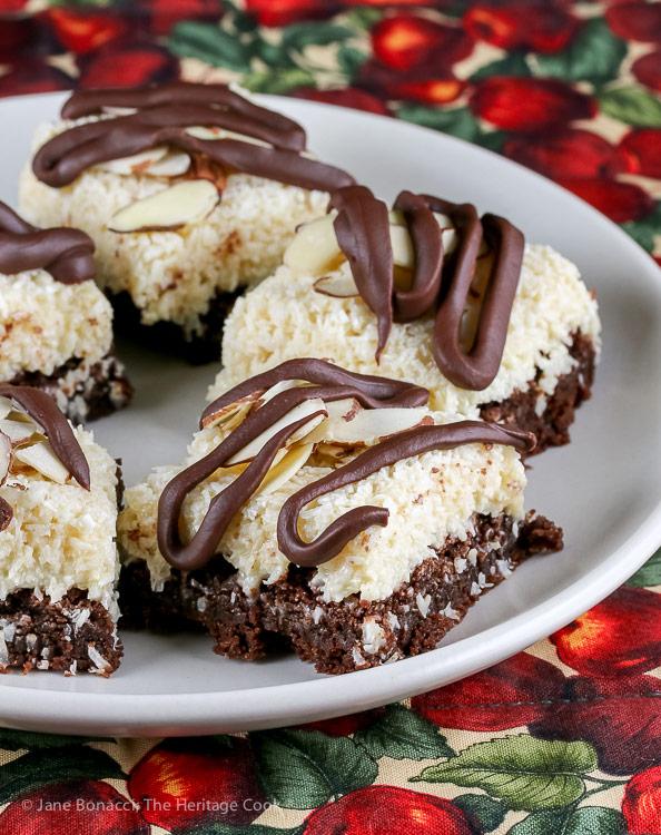 plate of coconut brownies; Rich Coconut Almond Brownies © 2019 Jane Bonacci, The Heritage Cook
